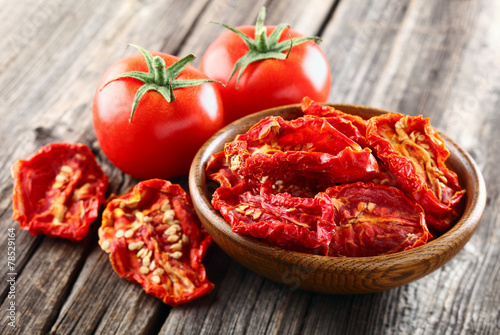 Tomato in a wooden background - 78529164