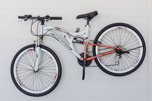 Bicycle Hanging On White Wall