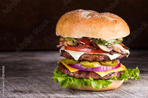 Fotografie, Obraz  Double patty hamburger with a variety of ingredients