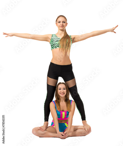 Two sporty girlfriends posing at camera