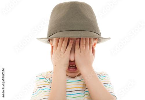 Fényképezés  child hide peek a boo hat retro portrait closeup