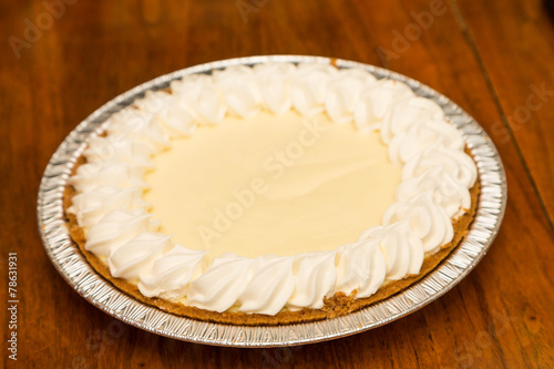 Fotografia, Obraz  Whole Lemon Meringue Pie on Wood Table