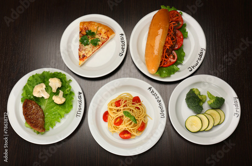 Daily menu. Plates with food on table © Africa Studio