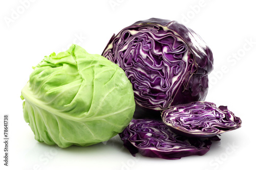 Slika na platnu Freshly cut red and white cabbage on a white background