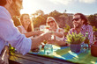 canvas print picture - cheerful friends drinking cocktails