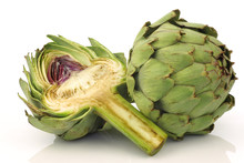 One Whole And Cut Artichoke On...
