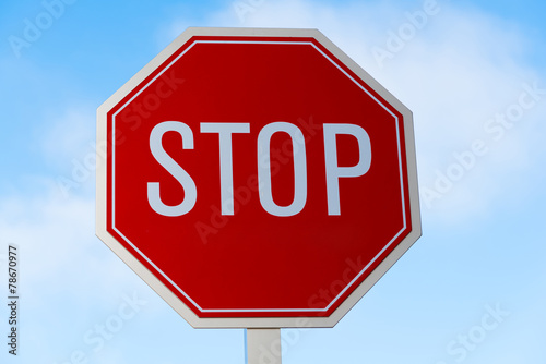 Fotografie, Obraz  Stop sign in southern California with a sky blue background