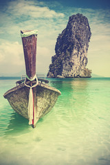 Fototapeta 3D Retro vintage filtered picture of a wooden boat on beach, Thailand.