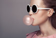canvas print picture - Beautiful blonde woman. Fashion portrait. Blowing bubble gum.