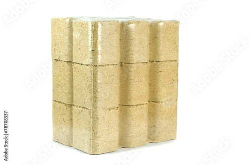 Valokuva  A multipack of wooden briquettes on a white background