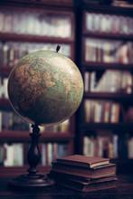 Antique Globe And Books In A L...