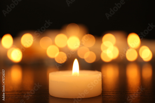Burning candles on dark background Canvas Print