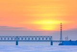 railway bridge over a frozen river - 78748394