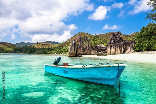 Montage in der Fensternische Tropical strand Old fishing boat on a Tropical beach at Curieuse island Seychell