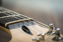 Guitar Riff With Strings And Tuning Knobs