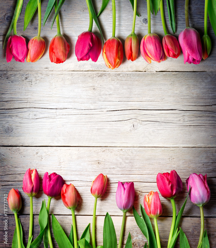 Foto op Aluminium Tulp tulips on vintage wood - easter background
