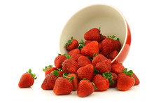 Fresh Strawberries In A Red Ceramic Bowl On A White Background