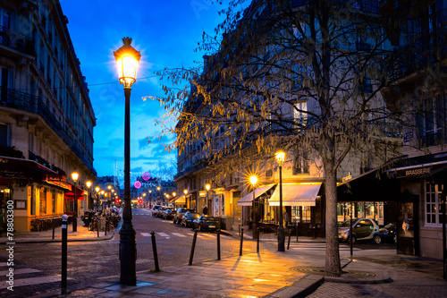 Paris beautiful street in the evening with lampposts Poster