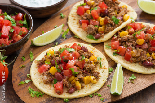 tortillas with chili con carne and tomato salsa on wooden board Plakát