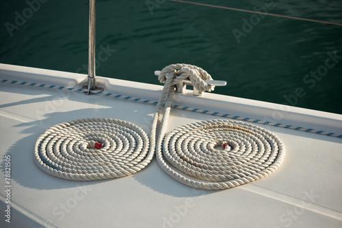 Nautical mooring ropes on a boat Fototapeta