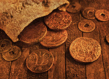 Ancient Coins On Wooden Backgr...