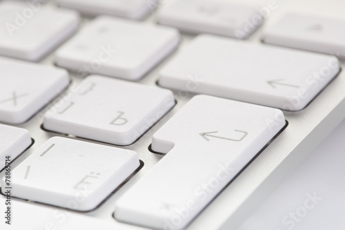 White computer keyboard close-up  Focused on 'Enter' key - Buy this