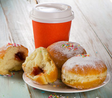 Homemade Donuts And Coffee Cup On  Wooden Table.