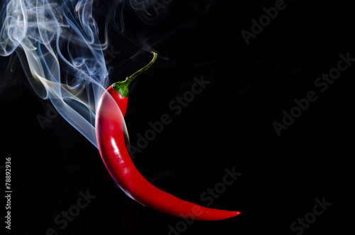Foto auf Gartenposter Hot Chili Peppers Smoking red hot chili pepper on black background