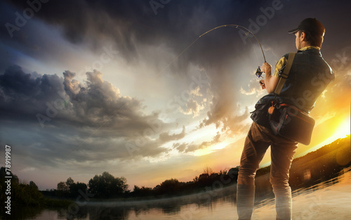 Printed kitchen splashbacks Fishing Young man fishing at dramatic sunset