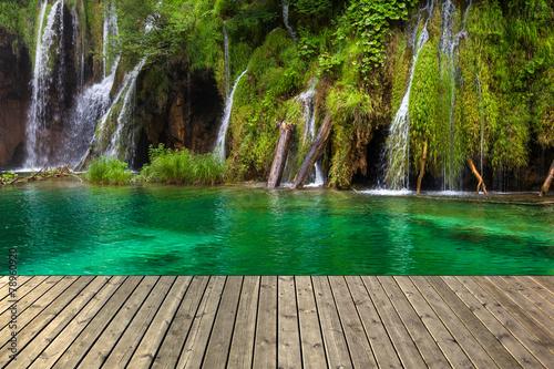 Waterfall in Plitvice lake and wooden plank, Croatia. #78960920