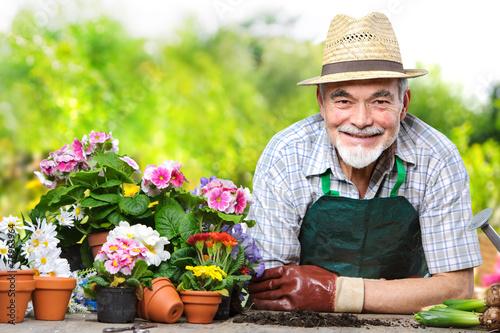Staande foto Tuin Senior in the flower garden