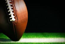 American Football On Green Gra...
