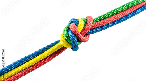 Obraz Tie from colorful ropes isolated on white - fototapety do salonu