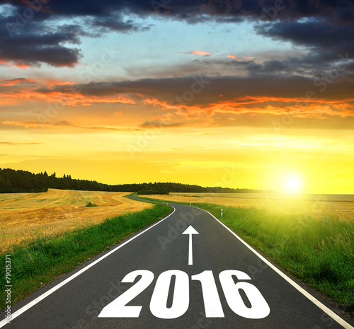 Poster  Asphalted road at sunset .Forward to the New Year 2016