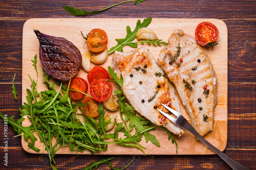 Grilled turkey steak on a cutting board - 79039394