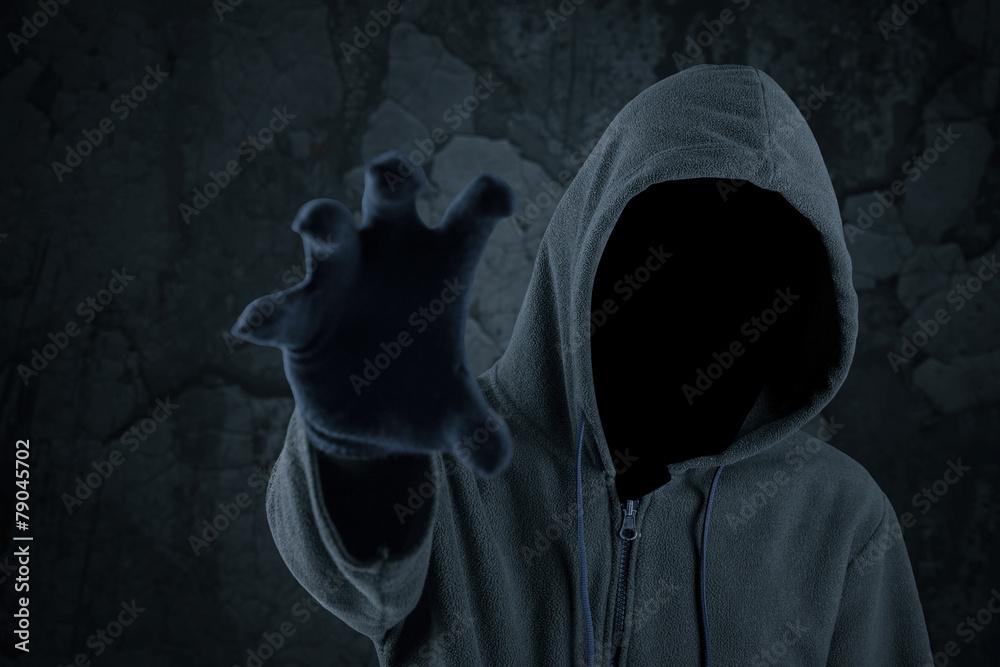 Fototapeta Burglar with hoody grabbing something
