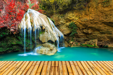 Fototapetawonderful waterfall in thailand with bamboor floor