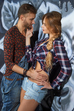 Vertical Portrait Of A Loving Couple On Graffiti Background
