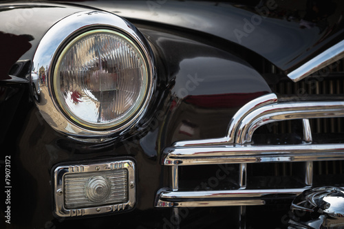 Old vintage car front lights or headlights Wallpaper Mural
