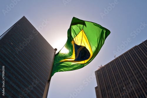 Poster Amérique du Sud Brazilian National Flag against Skyscrapers by Sunset