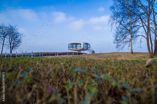 Foto op Canvas UFO UFO am Horizont der Küste