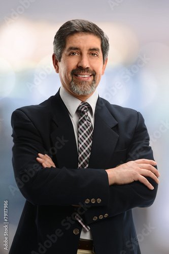Senior Businessman With Arms Crossed Buy This Stock Photo