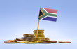 canvas print picture - Flag of South Africa in a stack of coins.(series)