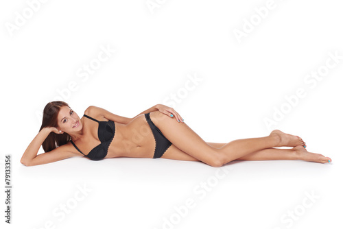 Fotografie, Obraz  Woman lying down in lingerie
