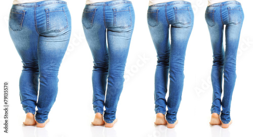 Fotografía  Woman in blue jeans isolated on white background