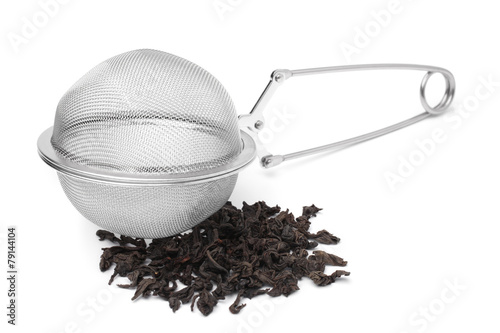 Fényképezés  Tea infuser with a handful of tea