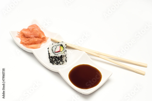 Fototapeta maki sushi  with pickled ginger and soy sauce on white ceramic plate and chopsticks on white background obraz