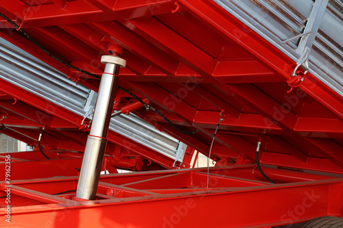 Fotografia, Obraz  big Pneumatic cylinder below the truck in the yard