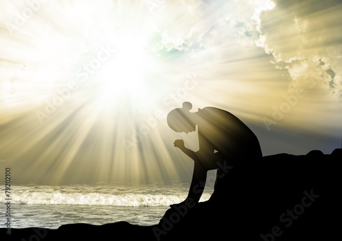 Silhouette of woman praying to god