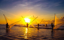 Fishermen Fishing In The Sea A...